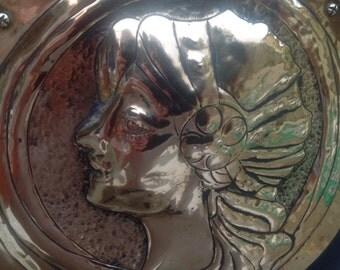 Antique metal plaque