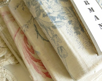 4 wonderful antique books, wrapped in beautiful french fabric....CHARMANT!