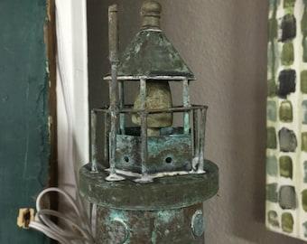 Vintage lighthouse weathervane