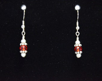 Red dangling earrings.