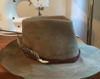 Western wide brim custom fedora with a tear drop crown real turkey feathers