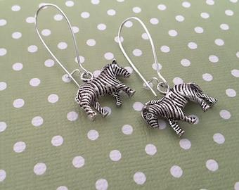 Silver Zebra Dangles . Earrings