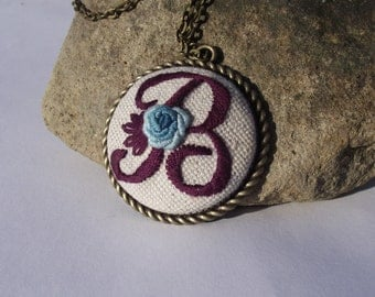 Hand embroidered pendant with letter B