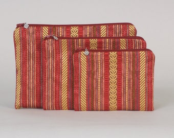 3-piece zipper pouch set: Rust/gold/green pattern stripe