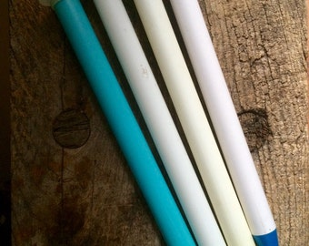 Group of 4 plastic hollow core size 50 knitting needles