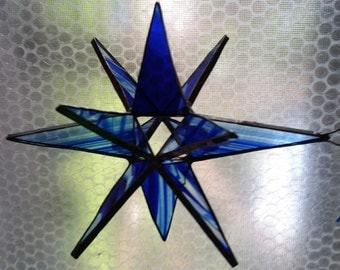 Cobalt blue on clear stained glass 12 point star ornament or sun-catcher.