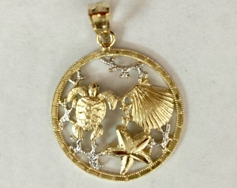 14k gold hawaii sea life turtle,sea shell & star fish pendant.