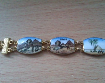gold coloured enamelled bracelet