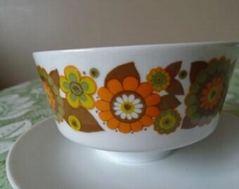 funky orange flowered dish integrated saucer.