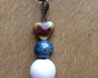 Waxed cord necklace and ceramic pendant