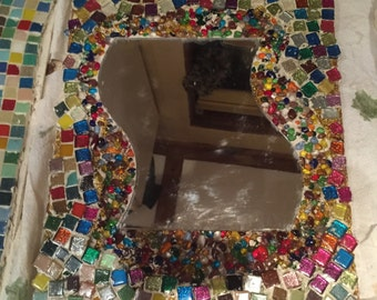 Mirror with beads and tiles