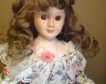Vintage Alco 1994 Porcelain Doll, With Original Tag and Stand, Brunette Curly Hair, Spring Color Floral Dress, w/ Purple Hair Bow