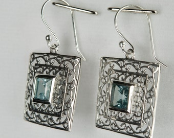 B001-012-001 Handmade Sterling Silver Hoop Earrings Blue Topaz December Birthstone