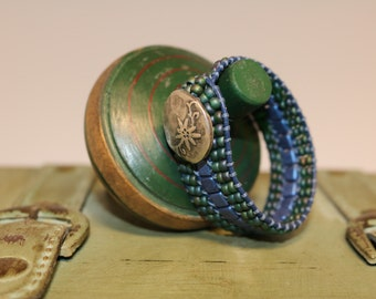 Cuff Wrap Bracelet.  Shades of blue beads with darker blue leather.  Beautiful Metal Button
