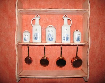 Antique kitchen shelf with ceramic jars