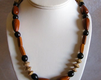 Kamagong beaded necklace with burnt dice and wood drop bead accents