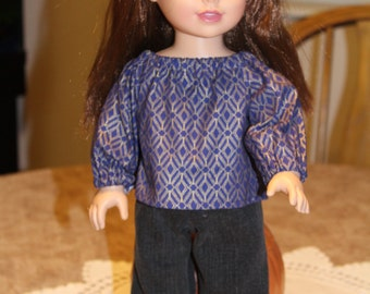 Purple and gold long-sleeved blouse with jeans