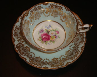 DW Paragon Gold and Creamy Blue with Floral Bouquet Cup and Saucer