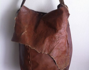 Brown men's designer big bag, shoulder bag on a long strap, a bag made of genuine leather.