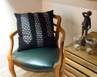Cushion cover with ground tie applied