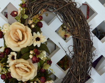Oval and Cream Floral Grapevine Wreath