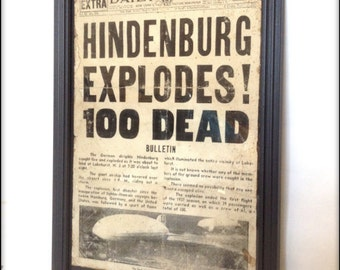 Reproduction Hindenburg Disaster newspaper front cover in frame.