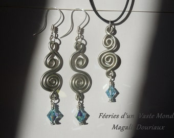 Spiral ornament in pewter and tops Svarowsky aquamarine