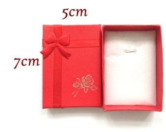 Small decorated 5 cm by 7cm red gift box