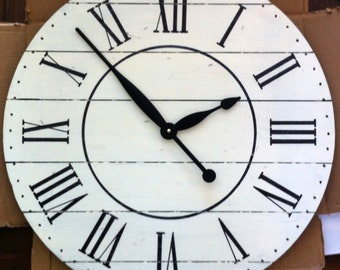 Off-White Distressed Clock with plank detailing, perimeter dots and inner black circle.