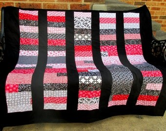 Black, white and red lap quilt
