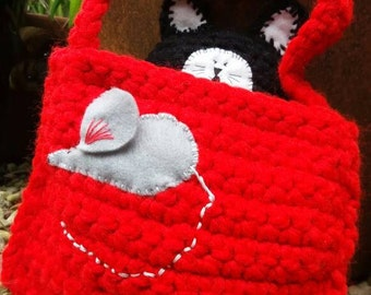 Little black cat with red mouse bag