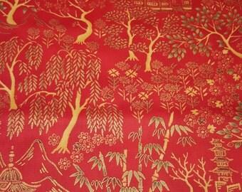 E969 Crimson/Gold Print Fabric from Hoffman Fabrics