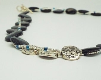Hatshepsut's Dream - midnight blue shell necklace with stamped silver beads