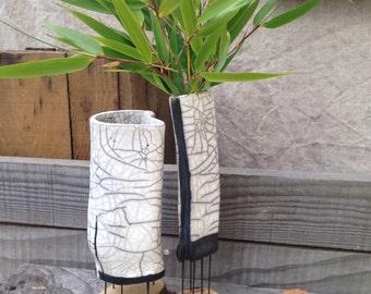 Raku vase and wood on stilts