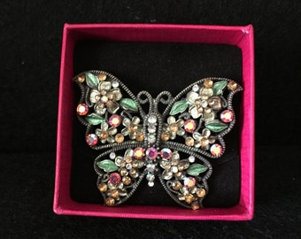 A beautiful jewel encrusted butterfly brooch
