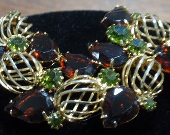 Multiple colored stone gold tone brooch