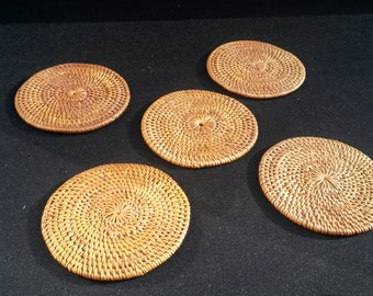 Set of 5 round hand woven wicker rattan coasters smoked over coconut