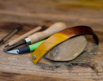 Leather strap with snap closure, brown yellow with history, tooled, hand dyed