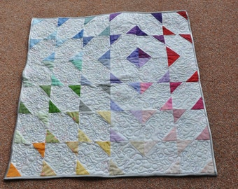 Colourful baby mat converts to bag (quag)