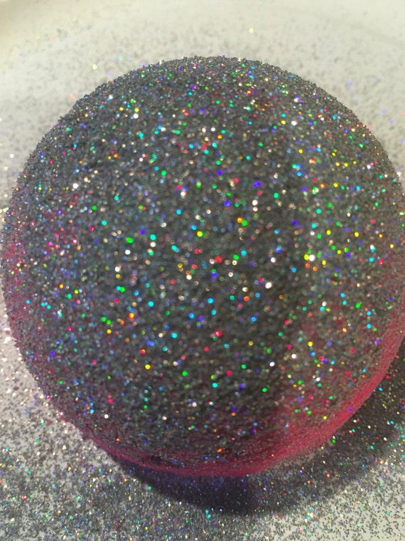 Glitter bomb turn your bath water into a pool of silky for How to make swimming pool water sparkle