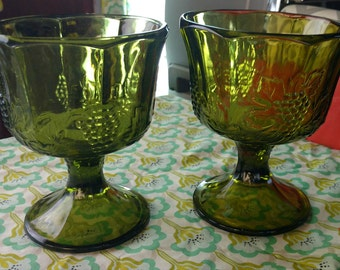Set of two vintage green glass bowls.