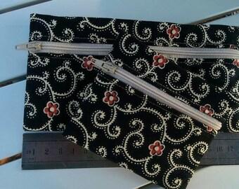 E055Set of two zippered pouches
