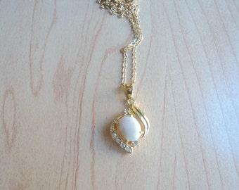 Vintage Canadian jade pendant. Jade nephritis champagne color (cream). Pendant color gold. Pendant with zircon.