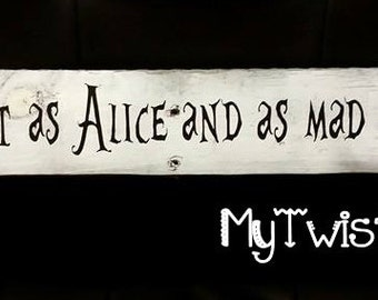Im About as lost as alice and as mad as the hatter Wood sign