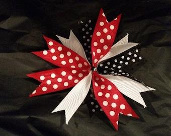 red and black polka-dot hair bow