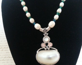 Lovely genuine freshwater pearl necklace with mother pearl pendant.