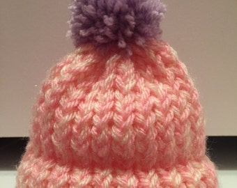 Newborn bobble hats.
