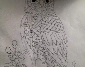 Owl on a branch with a key around the neck tattoo design