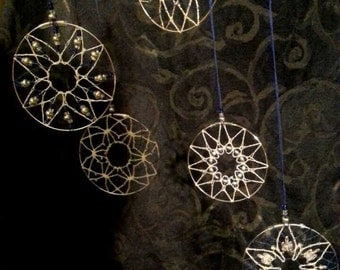 Hanging mobile discs - handmade lace