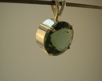 19.8 ct., Round Green Amethyst Pendant, 17.4mm x 11mm, set in .925 Sterling Silver.